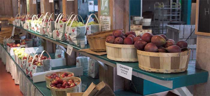 A New England Farm Market at Mack's Apples in Londonderry, New Hampshire. Apples and Pears line the shelves.